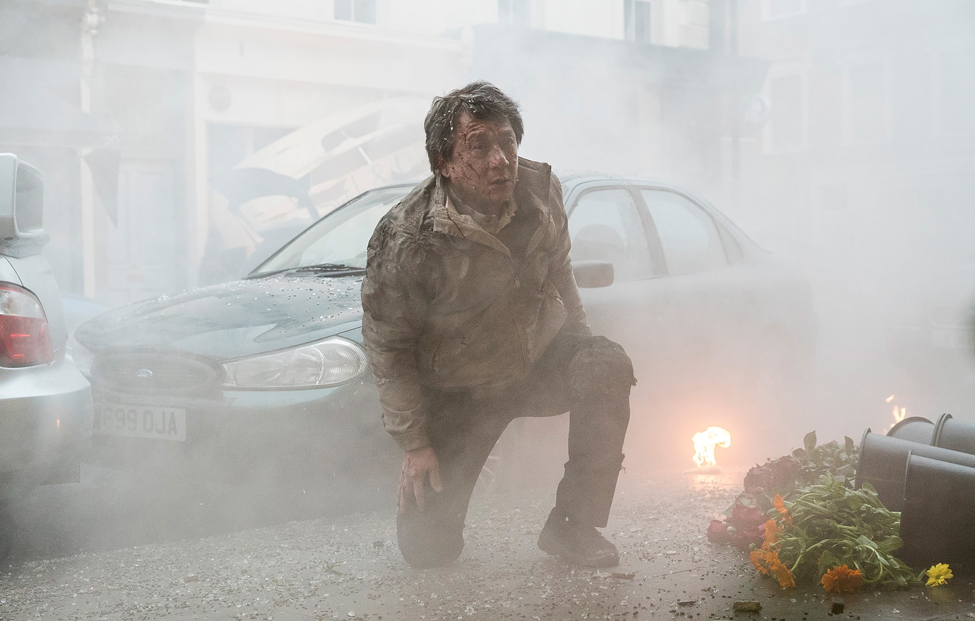 chris-raphael-sony-alpha-7SII-jackie-chan-kneels-by-a-building-following-an-explosion